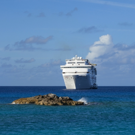 caribbean cruise: cruise ship anchored off the coast of the bahamas