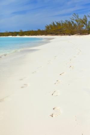 footprints on tropical beach in bahamas