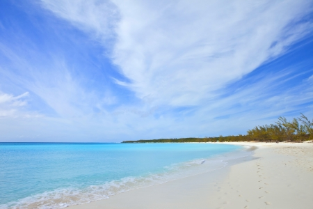 footprints on tropical beach in the bahamas