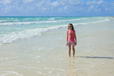 bahama: little girl in the waters of the caribbean on grand bahama Stock Photo