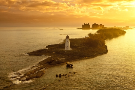 caribbean island: lighthouse and resort on nassau, bahamas at dawn Stock Photo