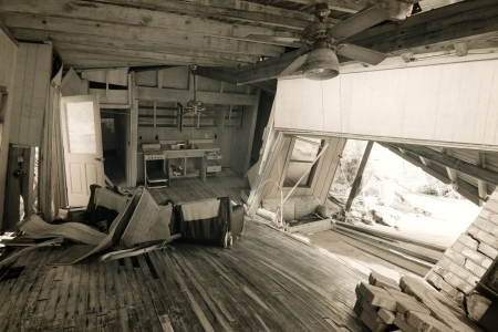 wrecked home interior after natural disaster photo