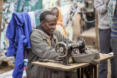 africa antique: OROMIA, ETHIOPIA-NOVEMBER 5, 2014: Unidentified factory worker sews clothing in Oromia, Ethiopia Editorial