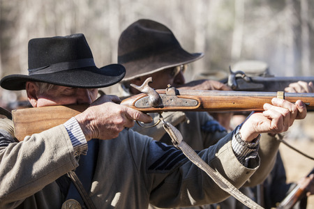 rifleman: SHELDON, SOUTH CAROLINA-JANUARY 25, 2015: Soldiers fire a musket volley during a reenactment of the battle of Pocotaligo