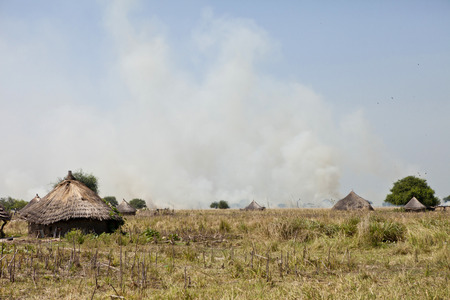 south space: African village in South Sudan and grassfires