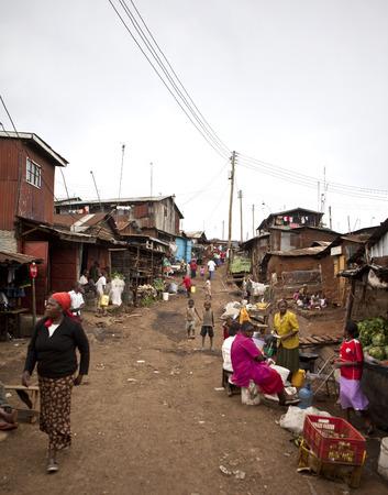 nairobi: KIBERA, KENYA-DECEMBER 6 2010: Unidentified people go about their business in Kibera, Nairobi Kenyas largest slum