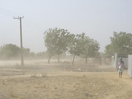 rips: BOR, SOUTH SUDAN, FEBRUARY 27, 2013: Dust storm rips through Bor, South Sudan with temperatures around 110 fahrenheit. Editorial