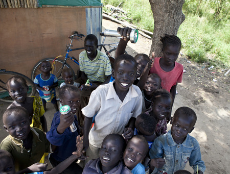 BOR, SOUTH SUDAN-DECEMBER 2, 2010: Unidentified school children smile and play in the town of Bor, South Sudan