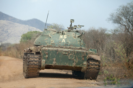 northern army tank in road in south sudan Stok Fotoğraf - 38139952
