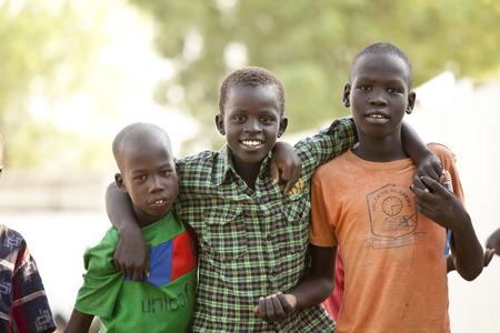 BOR, SOUTH SUDAN-FEBRUARY 26 2013: Unidentified children play in the village of Bor, South Sudan Editoriali