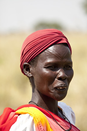 south sudan: LILIIR, SOUTH SUDAN- DECEMBER 4 2010: Unidentified Dinka woman with tribal scarification in South Sudan