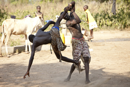 BOR, SOUTH SUDAN-DECEMBER 4 2010: Unidentified South Sudanese tribal wrestlers compete in a village north of Bor, South Sudan