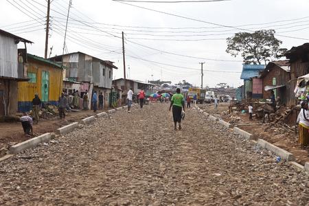KIBERA, KENYA: DECEMBER 6 2010- Unidentified people go about their business in Kibera, Kenya. Kibera is Africas largest slum.