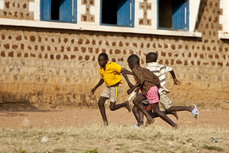 south sudan: TORIT, SOUTH SUDAN-FEBRUARY 20 2013: Unidentified boys play soccer in the town of Torit, South Sudan