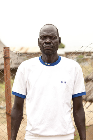 TORIT, SOUTH SUDAN-FEBRUARY 21 2013: Unidentified man with tribal scarification in the town of Torit, South Sudan Editorial