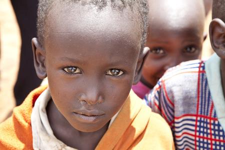 third eye: BISIL, KENYA: DECEMBER 7, 2010- Unidentified Maasai children in the village of Bisil in southern Kenya. Editorial