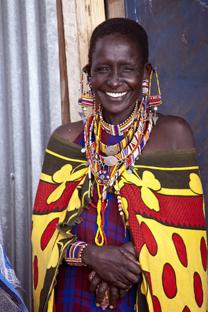maasai: BISIL, KENYA-DECEMBER 7, 2010: Unidentified Maasai woman near the village of Bisil in southern Kenya wears traditional jewelry and tribal piercings