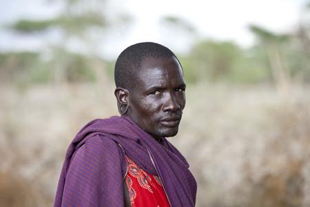 finery: BISIL, KENYA-DECEMBER 7 2010: Unidentified Maasai warrior in the village of Bisil in Southern Kenya