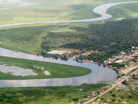 white nile: aerial view of nile river and town in south sudan