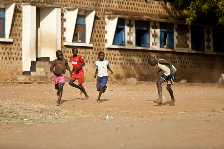 south africa soil: TORIT, SOUTH SUDAN-FEBRUARY 20 2013: Unidentified boys play football in the town of Torit, South Sudan Editorial