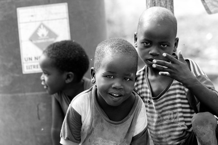 TORIT, SOUTH SUDAN-FEBRUARY 21 2013: Unidentified boys play in the town of Torit, South Sudan Stock Photo - 38140060