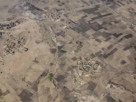 overhead view: Aerial view of dry farmland and villages in Ethiopia