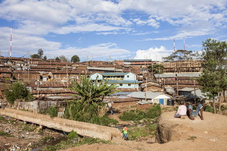 marginal: KIBERA, KENYA- NOVEMBER 10, 2015: Unidentified people go about their business at the edge of Kibera, Africas largest urban slum