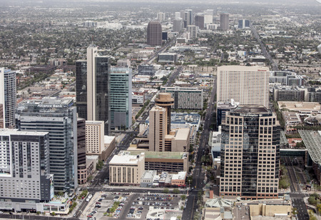 PHOENIX, ARIZONA- MARCH 13, 2014: A low aerial flyover of the downtown business district of Phoenix, Arizona.