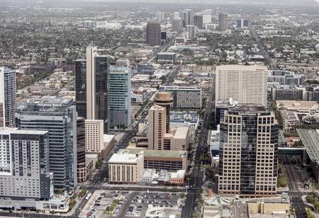 arizona: PHOENIX, ARIZONA- MARCH 13, 2014: A low aerial flyover of the downtown business district of Phoenix, Arizona.