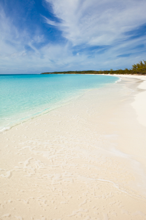 beautiful untouched beach with clear turquoise water in the bahamas