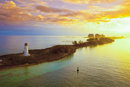 providence: nassau bahamas lighthouse and harbor at dawn with dramatic clouds Stock Photo
