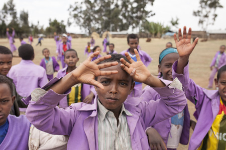 africa child: OROMIA, ETHIOPIA-APRIL 21, 2015: Unidentified school children play outside their school in the highlands of Ethiopia