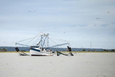 Commercial fishing boat catching shrimp in South Carolina Archivio Fotografico