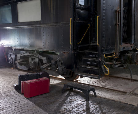embark: Baggage in front of train car waiting for departure Stock Photo