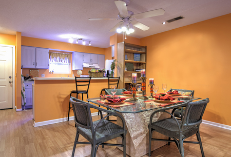 diningroom: Open concept apartment with diningroom and kitchen and orange walls