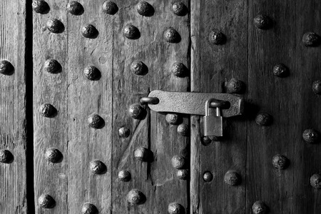 latch: Ancient wooden door with latch and lock