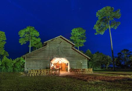 barns: Wedding reception in lit up barn at night