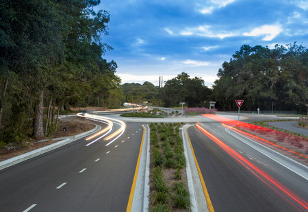 light trails: Traffic roundabout with light trails from cars Stock Photo