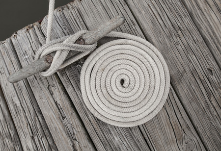 mooring: Coild of rope on weathered dock