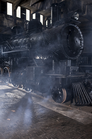 steam locomotive: Steam locomotive at the station with steam and dramatic lighting Stock Photo