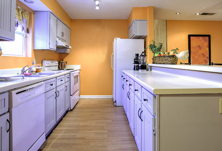 dated: Dated kitchen in need of remodel, galley style kitchen Stock Photo
