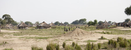 south africa: BOR, SOUTH SUDAN-DECEMBER 3, 2010:Unidentified people go about life in a small village in South Sudan