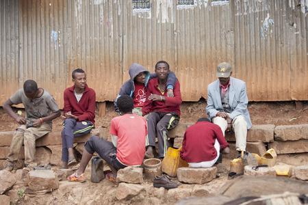 addis: ADDIS ABABA, ETHIOPIA-NOVEMBER 1, 2014: Unidentified shoe shiners work on a street in Addis Ababa, Ethiopia