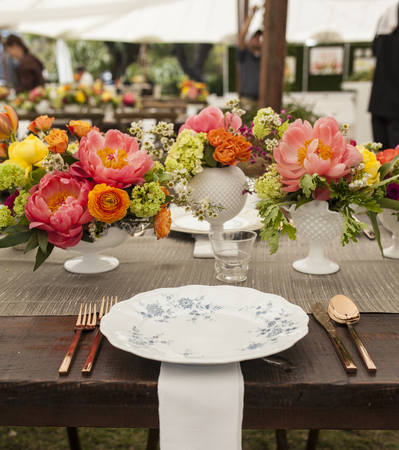 china rose: antique place setting and flowers for wedding reception Stock Photo