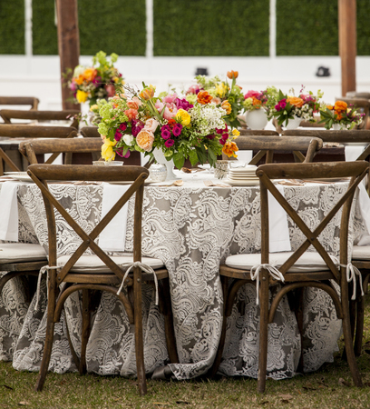 Low angle view of tables set up for wedding reception Standard-Bild