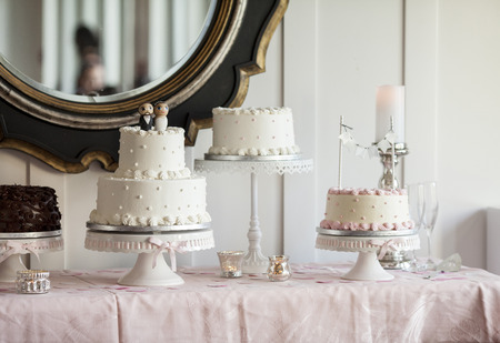 nuptial: Table full of wedding cakes at reception Stock Photo