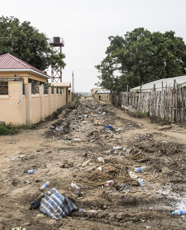 south africa soil: Trash fills a dirt road in Juba, capital city of South Sudan