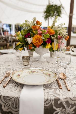 stemware: setup for wedding reception with antique plates and stemware Stock Photo