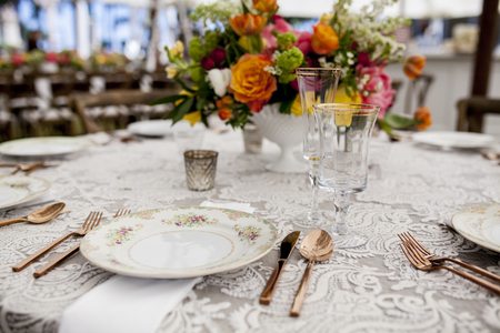 china rose: table set for wedding reception with antique dishes