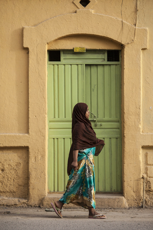 dire: DIRE DAWA, ETHIOPIA-APRIL 16, 2015: Unidentified Somali woman walks on the streets of Dire Dawa, Ethiopia, near the Somali border